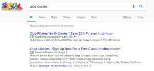 Google paid search results for yoga keyword