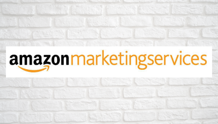 The logo of Amazon Marketing Services with a wall in the background